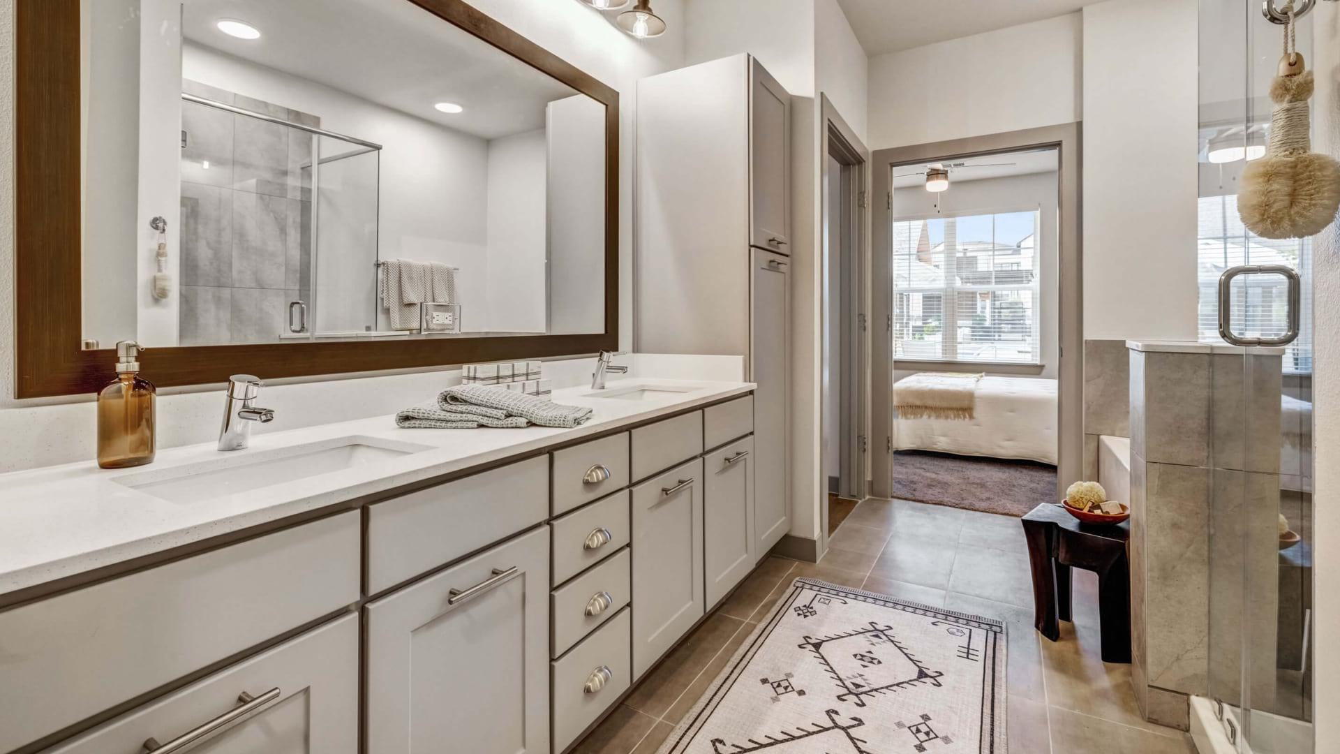 Bathroom with modern lighting and ample counter space